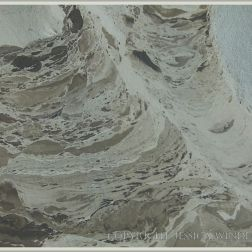 "Pattern in the ""skin"" forming on a recent liquified mud flow to the beach from the blue-grey Eype Clay Member"