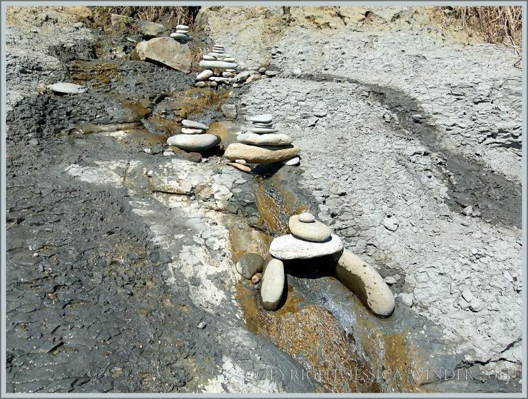 Little pebble bridges over a beach stream