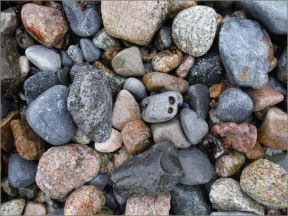 Wet pebbles on the beach