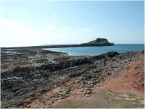 View of the exposed rock Worms Head Causeway at low tide