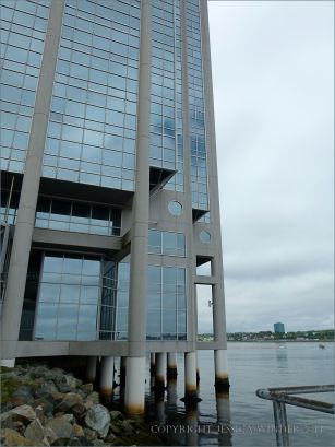 Waterside high rise building with barnacle encrusted support piles
