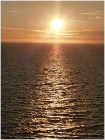Lowering sun over Rhossili Bay