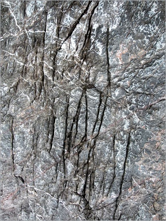 Detail of veining and fractures in limestone cliffs