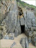 Entrance to a small cave on South Beach in Tenby