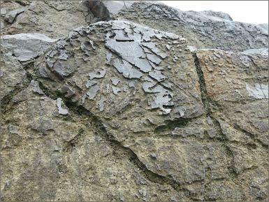 Fine irregular grooves and ridges on limestone