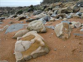 Sedimentary rock boulders on the seashore