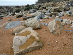 Sedimentary rock boulders on the seashore