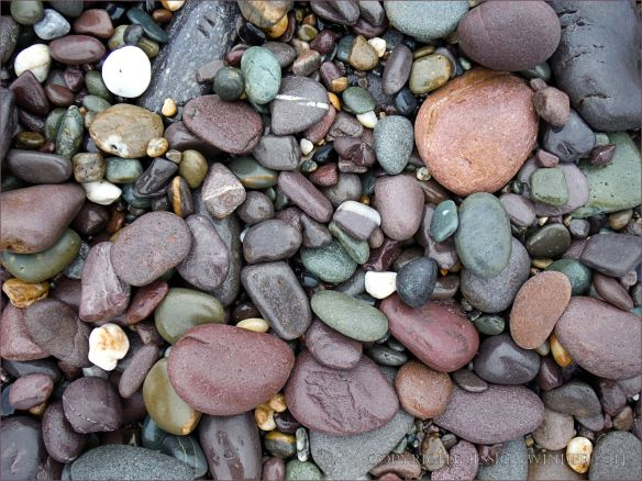 Pebbles of many colours on the beach
