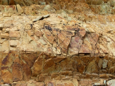 Patchwork of rusty rocks in the cliffs