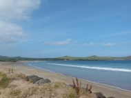 View looking northwest along the sandy beach at Smerwick Harbour