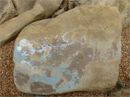 Pattern on the surface of a beach boulder