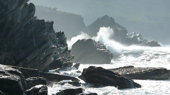 Waves breaking on rocks video clip