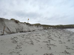Storm-damaged tombola sand dunes at Dogs Bay