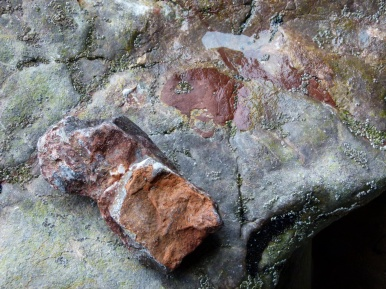 Red haematite on limestone at Rhossili cliffs