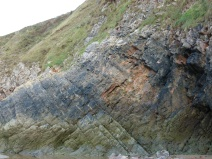 Cliff face with fresh loss of stone indicated by orange markings