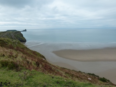 View along the cliff top at Rhossili towards Worms Head.