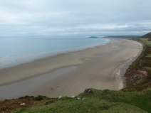 View of Rhossili beach looking towards Burry Holms