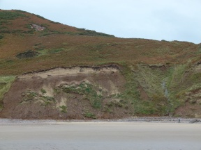 Red soil and slipping turf near the old path at Rhossili