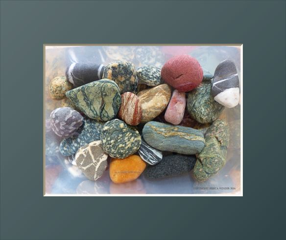 Assorted colourful and patterned pebbles