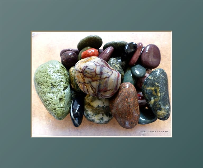 Collection of colourful wet glossy pebbles