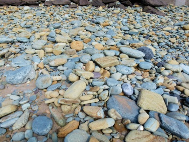 Pebbles on the beach at Clogher Bay