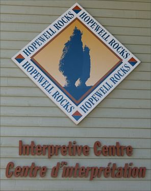 Sign for the Hopewell Rocks Interpretation Centre in New Brunswick, Canada, on the shore of the Bay of Fundy.