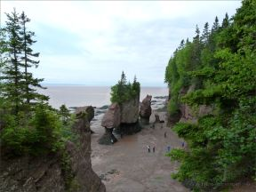 View looking down to the beach with cliffs and seastacks at Hopewell Rocks in New Brunswick.