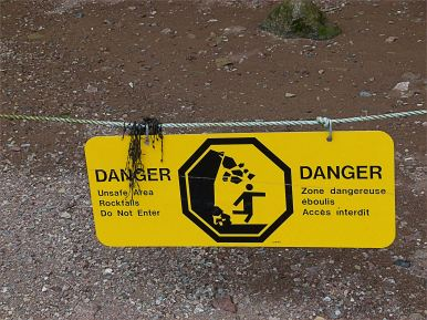 Warning sign of danger from falling rocks