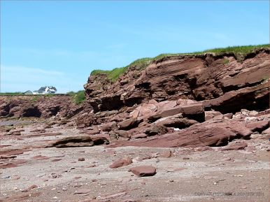Red Triassic rocks in low cliffs on Waterside Beach in New Brunswick
