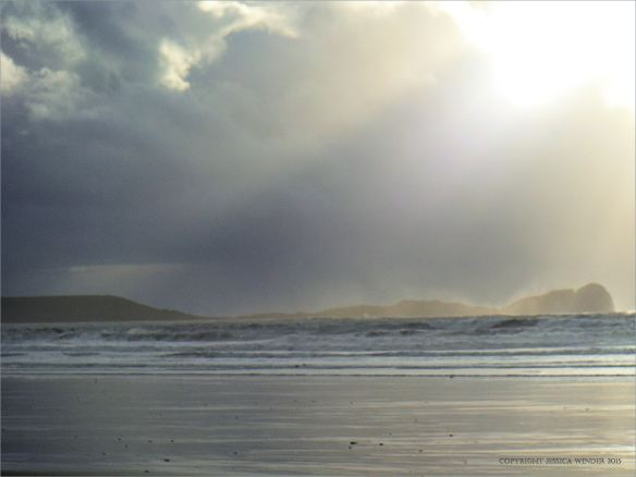 Cloud burst and sun shafts over Worms Head on the Gower Peninsula
