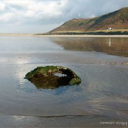 Rusty remains thought to be an old empty WWII mine on Rhossili beach
