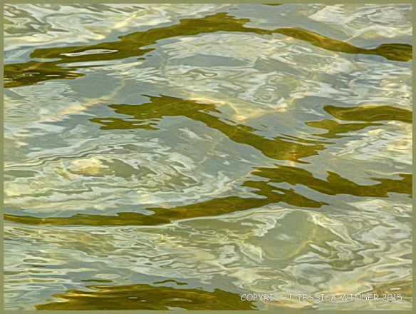 Light reflected on rippled water