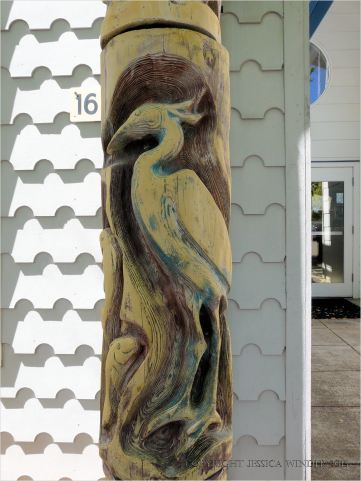 Wood carving of water bird on house in Eugene, Oregon.