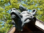 Bronze wolf head and mythical beast on museum in Eugene, Oregon
