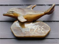 Wood whale carving on house at Yachats, Oregon.