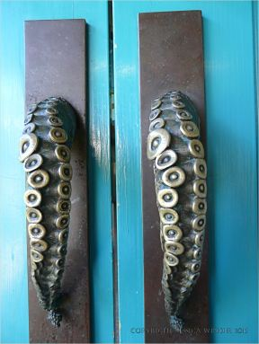 Door handles fashioned as suckered octopus arms