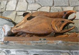 Carved wooden salmon wall decoration in Overleaf Lodge, Yachats, Oregon.