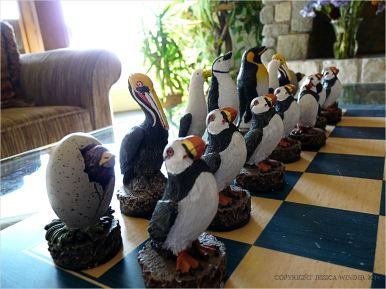 Carved and painted seabird chess pieces at Overleaf Lodge in Yachats, Oregon.