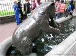 Bronze bear eating a salmon in a horse trough in Portland, Oregon