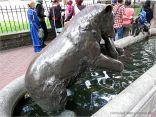 Bronze bear eating a salmon in a horse trough in Portland, Oregon