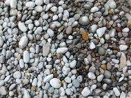 Pebbles on the water's edge at Pwll Du Bay