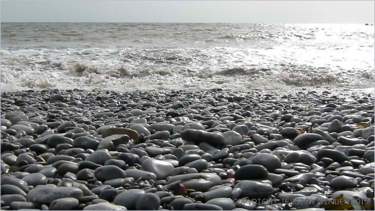 Sea-washed Carboniferous limestone pebbles at Pwll Du Bay