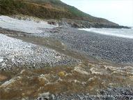 View looking east across Pwll Du Bay to Carboniferous Limestone rocks
