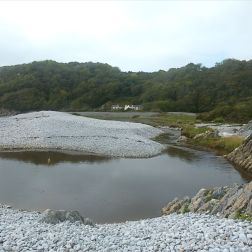 Water dammed behind the shingle banks at Pwll Du Bay