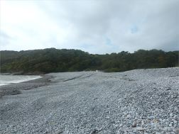 View looking west across the shingle banks at Pwll Du Bay