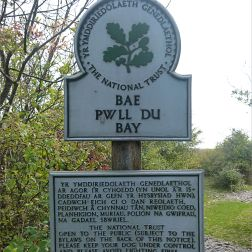 National Trust signpost at Pwll Du Bay