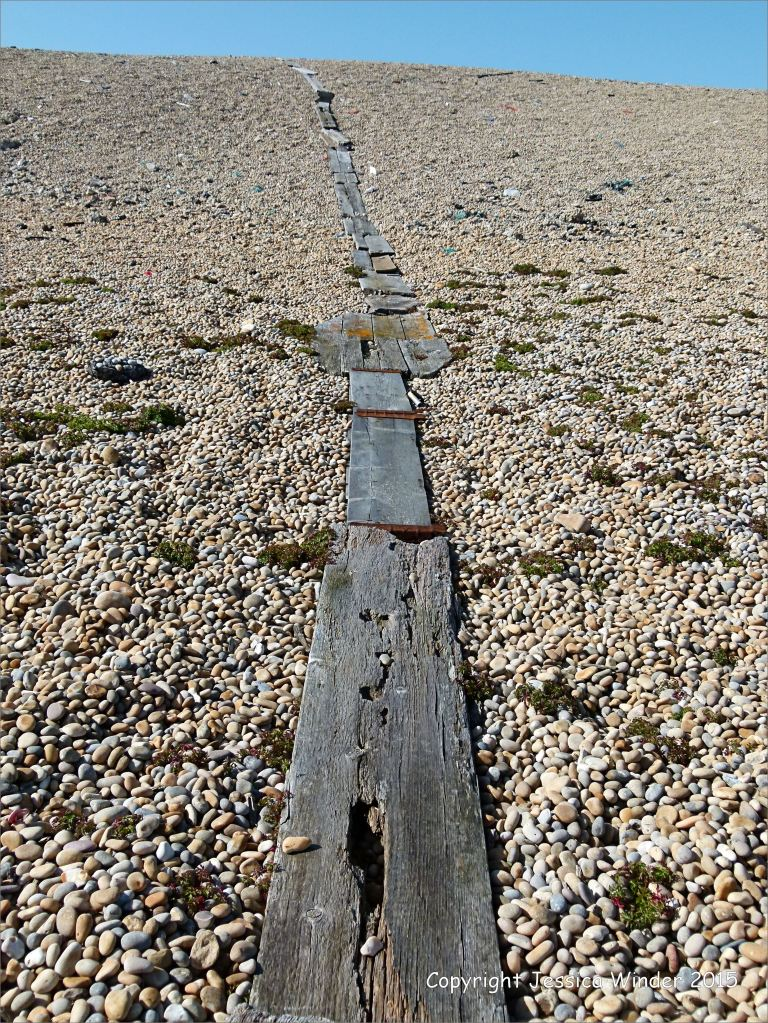 Makeshift boardwalk up the Chesil Bank in Dorset