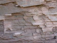 Layers of red Permian rock in a low cliff at Lord Selkirk Provincial Park on Prince Edward Island.