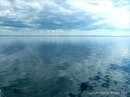 Still waters of the Northumberland Strait with reflected clouds viewed from the crossing ferry