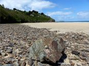 Beach stones and boulder on the upper west shore of Porth Kidney Sands in Cornwall